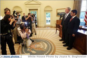 President George W. Bush stands with Sameer Mishra, 14, of Lafayette, Ind., during his visit Wednesday, Aug. 13, 2008, to the Oval Office of the White House. The teen was named the 2008 Scripps National Spelling Bee Champion in the 16th round after correctly spelling the word