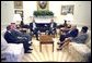 President George W. Bush, Secretary of State Colin Powell, and National Security Advisor Dr. Condoleezza Rice meet with the Foreign Ministers of Saudi Arabia, Egypt and Jordan in the Oval Office Thursday, July 18. They are (from left) Dr. Marwan Jamil Muasher of Jordan, Prince Saud Al-Faisal of Saudi Arabia and Ahmed Maher El Sayed of Egypt.