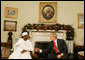 """President George W. Bush shakes hands with President Umaru Yar'Adua of Nigeria, as he welcomes him to the Oval Office Thursday, Dec. 13, 2007, at the White House. Said President Bush, """"Mr. President, I am impressed by your commitment to reform, your adherence to the concept of rule of law, and your belief in transparency. And I congratulate you for being a strong leader."""" White House photo by Joyce N. Boghosian"""
