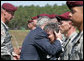 President George W. Bush embraces Barbara Walsh, mother of Sgt. First Class Benjamin Sebban, after receiving her son's posthumous Silver Star for gallantry presented by President Bush Thursday, May 22, 2008, during ceremonies at the 82nd Airborne Division Review in Fort Bragg, N.C. Sgt. First Class Sebban served valiantly as a Senior Medic in support of Operation Iraqi Freedom. White House photo by Chris Greenberg