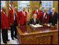 President George W. Bush is joined by members of the Tuskegee Airmen, Joint Chiefs Chairman Admiral Michael Mullen, center-background, and Department of Veterans Affairs Secretary James Peake, right, as he signs a Presidential Proclamation in honor of the 60th Anniversary of Armed Forces Integration, Wednesday, July 23, 2008 in the Oval Office at the White House.  White House photo by Eric Draper