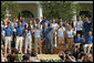 President George W. Bush joined by the members of the 2008 United States Summer Olympic Team wave to the crowd during a photo opportunity Monday, July 21, 2008, in the Rose Garden of the White House.  White House photo by Shealah Craighead