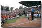 """President Bush kicks off the Little League World Series with a thank you to all the parents, coaches and volunteers who donate their time to childrens' sports during his induction ceremony into Little League's Hall of Excellence Aug. 26 in Williamsport, Pa. """"You prioritize your family and that's crucial for a healthy world, to make sure our families remain strong,"""" said the President. """"I equate Little League baseball with good families."""". White House photo by Moreen Ishikawa."""