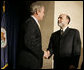 President George W. Bush shakes the hand of Ben Bernanke after he was sworn in Monday, Feb. 6, 2006, as Chairman of the Federal Reserve.  White House photo by Kimberlee Hewitt
