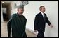 President George W. Bush and President Hamid Karzai of Afghanistan walk through the colonnade after meeting in the Oval Office Thursday, Feb. 27, 2003.  White House photo by Tina Hager