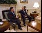 President George W. Bush meets with NATO Secretary General Lord Robertson in the Oval Office Wednesday, Feb 19, 2003.  White House photo by Eric Draper