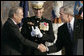 President George W. Bush and Secretary of Defense Donald Rumsfeld shake hands following President Bush's remarks honoring outgoing Secretary Rumsfeld during an Armed Forces Full Honor Review at the Pentagon Friday, Dec. 15, 2006, as Joint Chiefs of Staff Chairman General Peter Pace applauds.  White House photo by Paul Morse