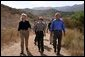 President George W. Bush walks with Secretary of the Interior Gale Norton, left, and Director of the National Park Service Fran Mainella at the Santa Monica Mountains National Recreation Area in Thousand Oaks, Calif. File photo.  White House photo by Paul Morse