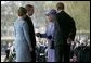 Arriving for the official ceremonial welcome for America's State Visit, President George W. Bush and Laura Bush are greeted by Her Majesty Queen Elizabeth and Prince Philip, Duke of Edinburgh, at Buckingham Palace in London Wednesday, Nov. 19, 2003. White House photo by Eric Draper.