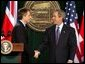 """President George W. Bush and British Prime Minister Tony Blair shake hands after they conclude a joint news conference at the Camp David, March 27, 2003. """"The United States and United Kingdom are acting together in a noble purpose. We're working together to make the world more peaceful; we're working together to make our respective nations and all the free nations of the world more secure; and we're working to free the Iraqi people,"""" President Bush said.  White House photo by Paul Morse"""