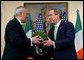 Irish Prime Minister Bertie Ahern presents a shamrock plant to President George W. Bush during an annual shamrock ceremony in the Roosevelt Room Thursday, March 13, 2003.  White House photo by Tina Hager
