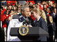 President George W. Bush is presented a team jacket from Paralympian Jennifer Armbruster after delivering his remarks to members of the 2008 United States Summer Olympic and Paralympic Teams Tuesday, Oct. 7, 2008, on the South Lawn of the White House.  White House photo by Eric Draper