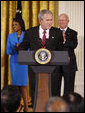 President George W. Bush welcomes guests to the East Room of the White House prior to signing H.R. 7081, The United States-India Nuclear Cooperation Approval and Nonproliferation Enhancement Act, Wednesday, Oct. 8, 2008, in the East Room at the White House. White House photo by Eric Draper