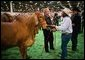 President George W. Bush greets a participant at the Houston Livestock Show and Rodeo Monday, March 8, 2004.  White House photo by Eric Draper