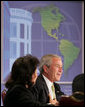 President George W. Bush makes remarks Monday, July 9, 2007, during A Conversation on the Americas at the Hyatt Regency Crystal City in Arlington, Va. The purpose of the gathering was to highlight extensive society-to-society relationships between the U.S. and its neighbors and to further promote the theme of how the United States helps its neighbors promote education, health care and economic opportunity at all levels. White House photo by Chris Greenberg