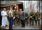 President George W. Bush visits with military personnel after attending a church service at Evergreen Chapel at Camp David, Maryland, Sunday, April 16, 2006.  White House photo by Eric Draper