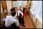 President George W. Bush is briefed by Under Secretary for Emergency Preparedness and Response, Mike Brown, on Tropical Storm Bonnie and Hurricane Charley at the City of Miami Fire House Number Two in Miami, Fla. Also present at the briefing were (from left) Laura Bush, Congressman Bill Young and Governor Jeb Bush, Friday, August 27, 2004. White House photo by Tina Hager