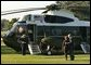 President George W. Bush and Laura Bush depart the South Lawn en route to Andrews Air Force Base, Friday, Sept. 10, 2004.  White House photo by Joyce Naltchayan