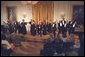 """The Show Choir from the Duke Ellington School of the Arts performs for President George W. Bush at the Celebration of African American Music, History, and Culture in the East Room May 28. """"The music and culture of Black Americans has brought great beauty into this world. Today it brings great pride to our country,"""" said the President."""