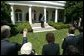 After welcoming the new members of Iraq's interim government, President George W. Bush answers questions from the press in the Rose Garden Tuesday, June 1, 2004.  White House photo by Eric Draper