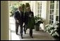 President George W. Bush and Hamid Karzai of Afghanistan walk along the colonnade after holding a joint press conference in the Rose Garden Tuesday, June 15, 2004. White House photo by Paul Morse.