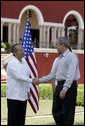 """President George W. Bush exchanges handshakes with Felipe Calderon, President of Mexico, during the arrival ceremonies Tuesday, March 13, 2007, welcoming the President and Mrs. Bush to the country. President Calderon told the President, """"Mr. President, I have no doubt that together our governments will move forward in the generation of new opportunities of well-being and prosperity for our nations. Please feel very, very welcome to Mexico."""" White House photo by Paul Morse"""