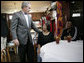 President George W. Bush meets with New Orleans Upper Ninth Ward resident Ethel Williams, left, and her daughter, Wanda, following a lunch meeting Thursday, March 1, 2007 in New Orleans with city and state officials, to talk about the rebuilding progress of areas devastated by Hurricane Katrina. President Bush met Ethel Williams and toured her hurricane damaged home in April 2006. White House photo by Eric Draper