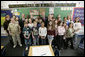 President George W. Bush is joined by Indiana Gov. Mitch Daniels, center, and Indiana Congressman Baron Hill, at left, as they pose for a photo with students and teachers Teri Sanders and Tammy Persinger in the fifth grade U.S. History class at the Silver Street Elementary School in New Albany, Ind., Friday, March 2, 2007.  White House photo by Eric Draper