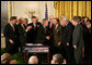 President George W. Bush shakes hands with U.S. Senator Arlen Specter, R. Pa., after signing H.R. 3199, USA PATRIOT Improvement and Reauthorization Act of 2005, Thursday, March 9, 2006 in the East Room of the White House. White House photo by Kimberlee Hewitt