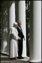 President George W. Bush and Pope Benedict XVI look out onto the Rose Garden from the Colonnade of the White House before their meeting Wednesday, April 16, 2008. The visit of Pope Benedict XVI is the first White House papal visit in three decades. White House photo by David Bohrer
