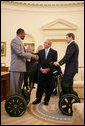 President George W. Bush talks with wounded veterans Sgt.Kortney Clemons, left, of Little Rock, Miss., and Sgt. Ryan Groves of Kent, Ohio, who both use a Segway as a mobility device, on a visit to the Oval office Tuesday, Oct. 16, 2007, attending a meeting of the President's Commission on Care for America's Returning Wounded Warriors. White House photo by Eric Draper