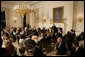 President George W. Bush welcomes guests to the Iftaar Dinner with Ambassadors and Muslim leaders in the State Dining Room of the White House, Thursday, Oct. 4, 2007. White House photo by Chris Greenberg