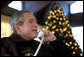 President George W. Bush speaks to members of the United States Armed Forces during Christmas Eve phone calls at Camp David, Saturday, Dec. 24, 2005.  White House photo by Eric Draper