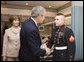 President George W. Bush shakes the hand of Marine Cpl. Andrew L. Tinsley of Annapolis, Md., Wednesday, Dec. 21, 2005, after Cpl Tinsley was presented the Purple Heart during a visit by the President and Laura Bush to the National Naval Medical Center in Bethesda, Md.  White House photo by Paul Morse