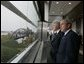 President George W. Bush and former President Bill Clinton tour the William J. Clinton Presidential Center and Park before participating in the dedication ceremony in Little Rock, Ark., Nov. 18, 2004.  White House photo by Eric Draper