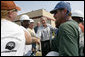 President George W. Bush greets construction workers outside the Folgers Coffee plant in New Orleans, LA, Tuesday, Sept. 20, 2005. White House photo by Eric Draper