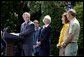President George W. Bush discusses his plan for wildfire prevention and forest stewardship, the Healthy Forests Initiative, in The East Garden Tuesday, May 20, 2003. Standing on stage with the President are, from left, Agriculture Secretary Veneman, Interior Secretary Gale Norton, Fire Management Officer Andrea Gilham and Wildlife and Fire Staff Officer Rex Mann.  White House photo by Susan Sterner
