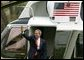 President George W. Bush waves as he departs for Camp David from the South Lawn Friday, April 4, 2003.  White House photo by Paul Morse