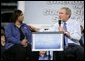 President George W. Bush leads the discussion on stage with Cynthia Roberts, a Nissan employee, during a Conversation on Strengthening Social Security Tuesday, May 3, 2005 at the Nissan North America Manufacturing Plant in Canton, Miss.  White House photo by Eric Draper