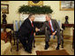 "President George W. Bush shakes hands with Jalal Talabani, President of Iraq, during a meeting Wednesday, June 25, 2008, in the Oval Office at the White House. President Bush said, ""It's been my honor to welcome a friend, President Talabani, back to the Oval Office. He is the President of a free Iraq. He is a man who's been on the front lines of helping to unify Iraq and to help Iraq recover from a brutal regime -- that of Saddam Hussein."" White House photo by Eric Draper"