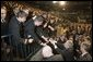 President George W. Bush reaches out to Midshipmen at the United States Naval Academy Wednesday, Nov. 30, 2005, in Annapolis, Maryland, where he spoke on the War on Terror. The President thanked the Midshipmen for volunteering to serve and told them America is grateful for their devotion to duty. White House photo by Paul Morse