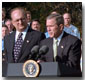 """Accompanied by firemen and other distinguished guests, President George W. Bush speaks during a ceremony held to honor the gift of a new firetruck for the city of New York on the South Lawn Dec. 19. Donated by the state of Louisiana, the """"Spirit of Louisiana,"""" will replace one of the 35 firetrucks that were destroyed in the Sept. 11 attacks. Standing with the President is Ronald Goldman (left), Louisiana Governor Mike Foster (center), and Louisiana Representative Hunt Downer. White House photo by Tina Hager."""