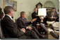 """Addressing the media, President George W. Bush meets with Norwegian Prime Minister Kjell Magne Bondevik in the Oval Office of the White House, December 5, 2001. """"We won't forget what took place,"""" said President Bush, referring to the Sept. 11 terrorist attacks. """"And we will bring them to justice."""" White House photo by Paul Morse."""