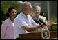 President George W. Bush briefs the media after meetings with the Defense and Foreign Policy teams Thursday, Aug. 11, 2005, at the Bush Ranch in Crawford, Texas. Secretary of State Condoleezza Rice and Secretary of Defense Donald Rumsfeld look on. White House photo by Eric Draper