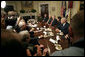 """President George W. Bush talks with the press after discussing Iraq with former Secretaries of State and Defense in the Roosevelt Room Friday, May 12 ,2006. """"Since we last met, a unity government is now in the process of becoming formed. I've got great hopes about this unity government,"""" said the President. """"We've got a Shia as the Prime Minister-designee, a Sunni as the Speaker, a Kurd as the President, all of whom have dedicated themselves to a country moving forward that meets the hopes and aspirations of the Iraqi people."""" White House photo by Eric Draper"""