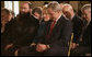 President George W. Bush is joined in prayer by Shirley Dobson, chairman of the National Day of Prayer Task Force, and Rabbi Sholom Ciment, the spiritual leader of Chabad-Lubavitch of Greater Boynton in Palm Beach County, Fla., during a celebration of National Prayer Day at the White House Thursday, May 4, 2006. White House photo by Eric Draper