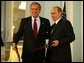 President George W. Bush and Russian President Vladimir Putin after exchanging documents of ratification inside the Konstantin Palace after a private meeting in St. Petersburg, Russia, June 1, 2003.  White House photo by Paul Morse