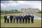 The G8 leaders pose of a photograph at Konstantinvosky Palace in Strelna, Russia, Sunday, July 16, 2006. From left, they are: Italian Prime Minister Romano Prodi; German Chancellor Angela Merkel; United Kingdom Prime Minister Tony Blair; French President Jacques Chirac; Russian President Vladimir Putin; President George W. Bush; Japanese Prime Minister Junichiro Koizumi; Canadian Prime Minister Stephen Harper; President of the European Union Prime Minister Matti Vanhanen of Finland, and European Commission President Jose Manuel Barroso. White House photo by Paul Morse