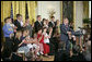 """President George W. Bush delivers remarks about stem cell research policy legislation in the East Room Wednesday, July 19, 2006. """"Each of these children was adopted while still an embryo, and has been blessed with the chance to grow up in a loving family,"""" said the President of children sharing the stage with him. """"These boys and girls are not spare parts. They remind us of what is lost when embryos are destroyed in the name of research."""" White House photo by Kimberlee Hewitt"""