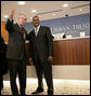President George W. Bush is welcomed by Bob Johnson, founder and chairman of the RLJ Companies, to the Urban Trust Bank for a discussion on the economy with small business owners and community bankers, Monday, Oct. 23, 2006 in Washington, D.C. White House photo by Eric Draper